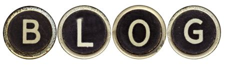 The word BLOG spelled in old typewriter keys.  Isolated on white.  Lots of dust and rust. photo