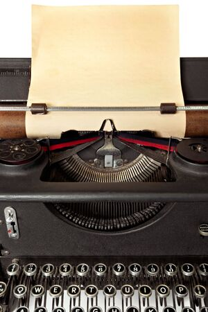 yellowing: Vintage typewriter with sheet of old blank yellowing paper. Stock Photo