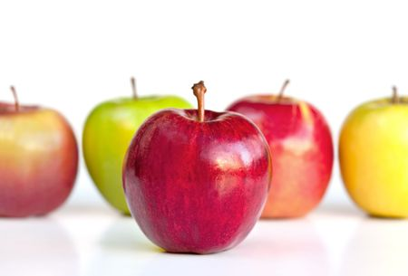 A red delicious apple stands out from other varieties including granny smith, golden delicious, fuji, and pink lady.  Shallow dof. photo