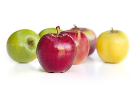 Selection of apple varieties, with red delicious apple out in front.  Isolated on white. photo