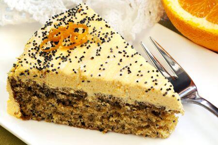 orange cake: Slice of orange cake with poppyseeds, wth a delicious cream frosting.