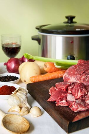 homely: Preparing a slow-cooker beef casserole.  Simple, homely food.