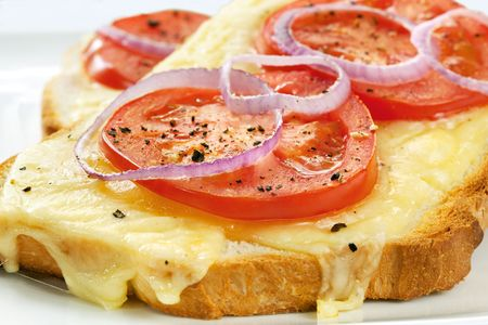 snacking: Toast topped with grilled cheese, tomato and red onion.  Delicious snacking!