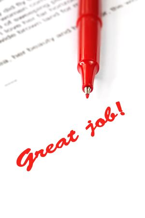 A red pen has written great job on a white printed page.   photo