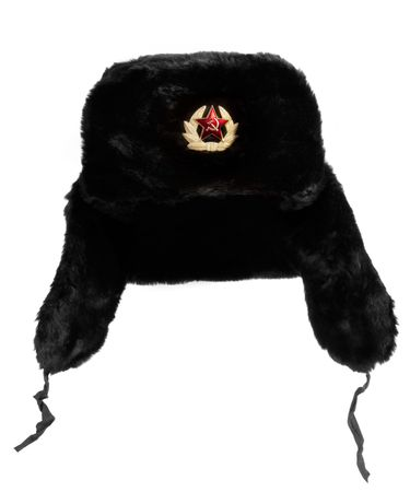 hammer and sickle: Black Russian fur hat, with hammer and sickle medallion.  Isolated on white.