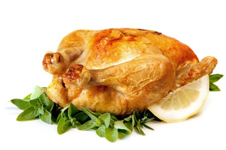 roasted chicken: Roast chicken, with herbs and lemon, isolated on white. Stock Photo