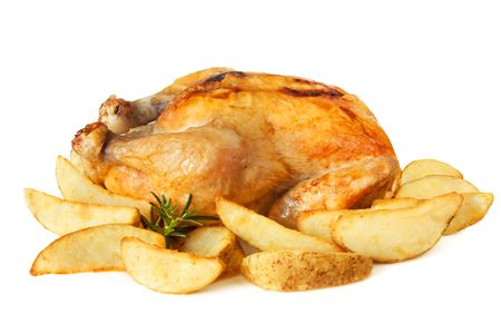 roast chicken: Whole roast chicken surrounded by potato wedges.  Over white. Stock Photo