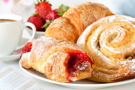 pastry: Continental breakfast with assortment of pastries, coffees and fresh strawberries.