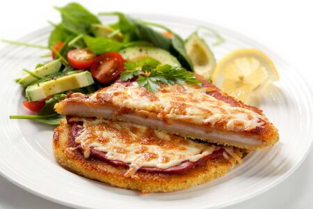 breaded: Delicious chicken schnitzel topped with passata and melting cheese, with a spinach and avocado salad.