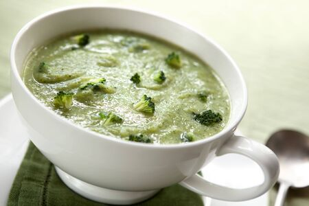 Cream of broccoli soup, in a soup mug.  Healthy eating. photo