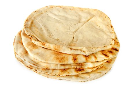 Stack of pita bread, isolated on white.