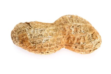 A single dry roasted peanut, in the shell, isolated on white. photo