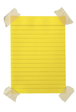 masking: Sheet of yellow lined notepaper with masking tape at the corners