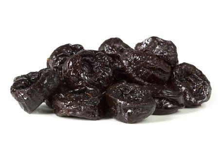 pitted: Sweet pitted prunes, isolated on white with soft shadow. Stock Photo