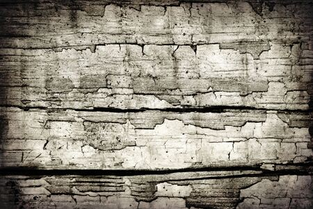 Grunge background of flaky paint on old timber.  Great cracks and textures. photo