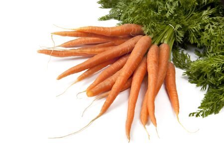Bunch of baby carrots with tops, over white background. photo