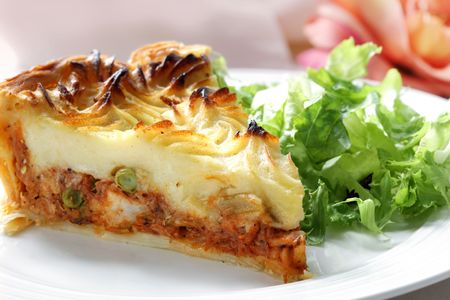 Shepherds pie with salad.  Meat and vegetable pie topped with mashed potato.  This is a chicken version.