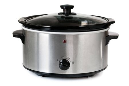 crock: Electric crock pot or slow cooker, isolated on white. Stock Photo
