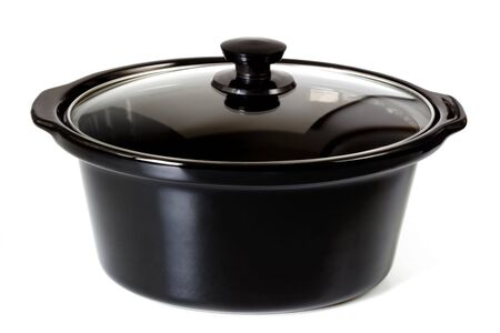 slow cooker: Black casserole dish or crock pot, isolated on white.