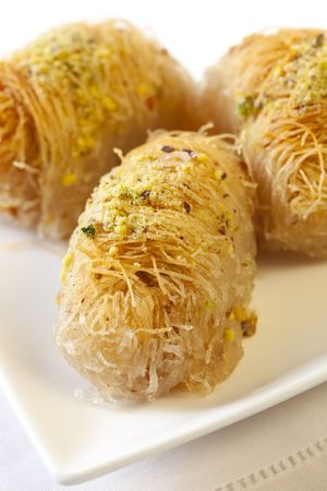 baklava: Kadayif, or Middle Eastern cakes with pistachios and honey.  Similar to baklava, sticky and sweet.