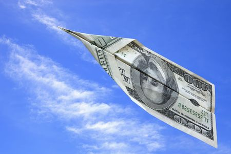 American one hundred dollar bill flying off into blue sky.  On the way up, or disappearing? Stock Photo - 6291246