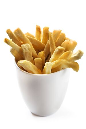 snacking: Home-made french fries in a white cup, ready for snacking.