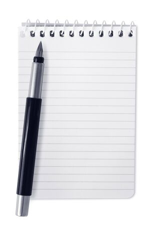 Small spiral notebook with fountain pen, isolated on white. photo