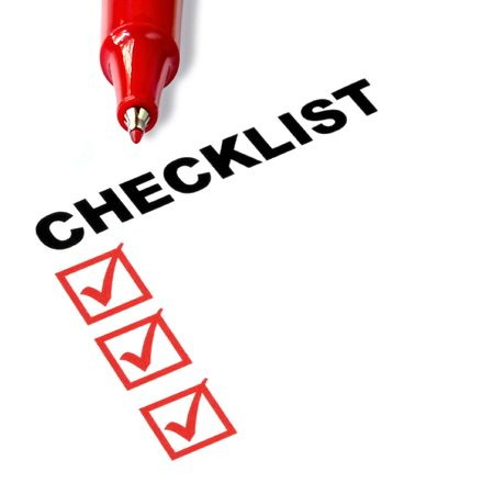 assess: Checklist with red felt pen, and checked boxes.
