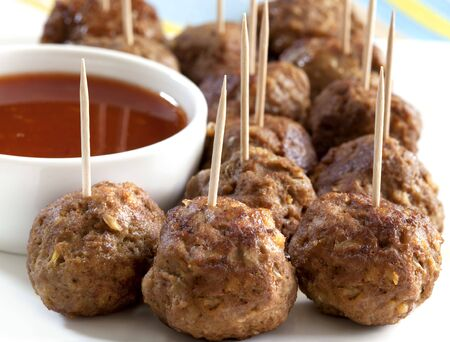 Meatball appetizers, with a dipping sauce. photo