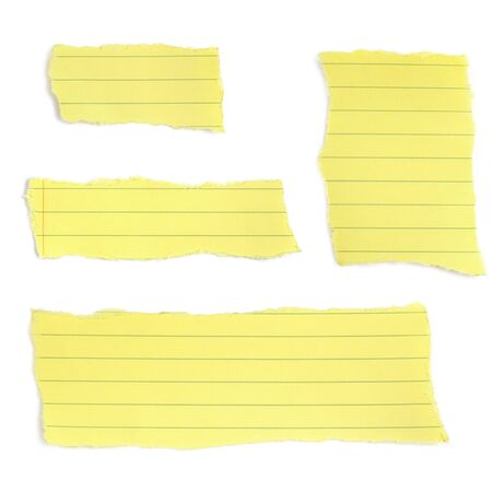Set of paper tears, from a yellow lined notepad.  Isolated on white with soft shadow. photo