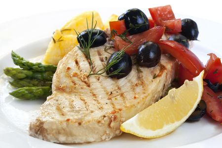 grilled potato: Swordfish with an olive and tomato salsa, asparagus, and roasted potatoes. Stock Photo