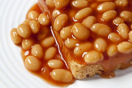 baked beans: Baked beans in tomato sauce, over sourdough toast.
