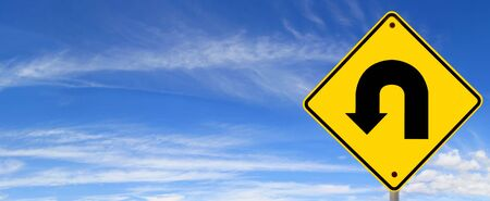 u turn sign: U turn road sign, against panoramic blue sky.  Time to change direction. Stock Photo