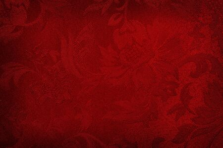 Red embroidered damask silk fabric, makes a rich background. photo