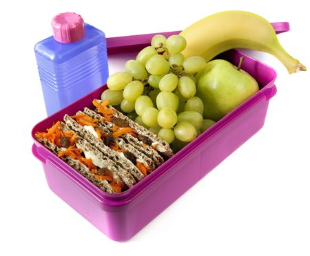 Healthy lunch in a bright pink lunch box.   photo