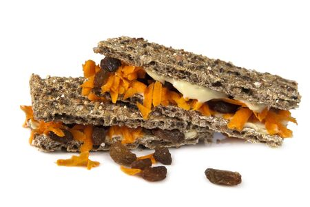 sultanas: Whole grain crispbread filled with cream cheese, carrot and sultanas.  Healthy, tasty snacking. Stock Photo