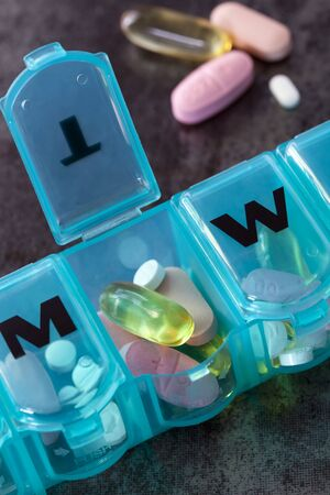 pill box: Daily pill box with medications and nutritional supplements.