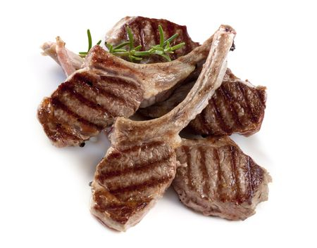 lamb chop: Grilled lamb cutlets with a sprig of rosemary. Stock Photo