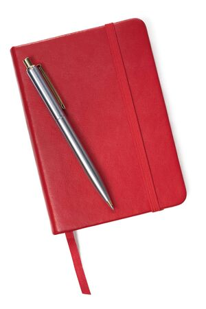 Little red leather covered book, closed, isolated on white, with silver ballpoint pen. photo