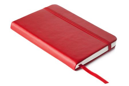closed ribbon: Red leather covered book, with ribbon placemark, isolated on white with soft shadow. Stock Photo