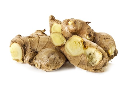 Fresh ginger root, in pieces, isolated on white background. photo