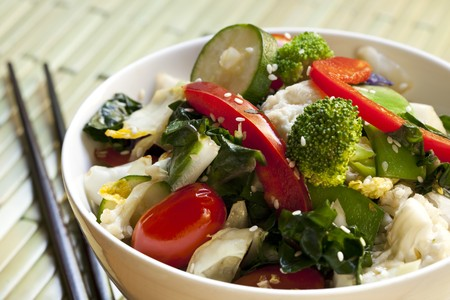 Bowl of stir-fried vegetables topped with sesame seeds.  With chopsticks.  Delicious healthy eating. Stock Photo - 7236979