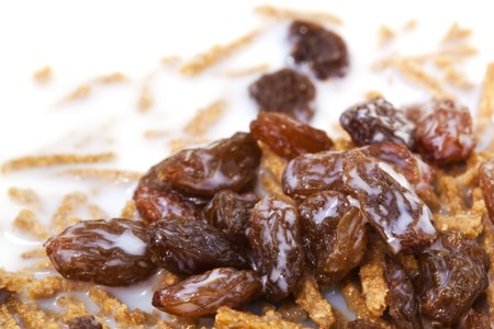 sultanas: Bran breakfast cereal topped with sultanas and low-fat milk.  Healthy, high-fiber eating.