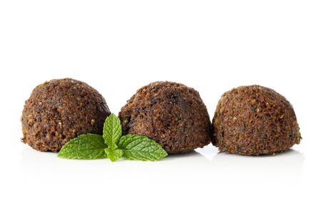 falafel: Falafel balls, isolated on white with a sprig of mint.