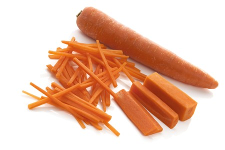 shredded: Stages of cutting julienne carrots.  Isolated over white.