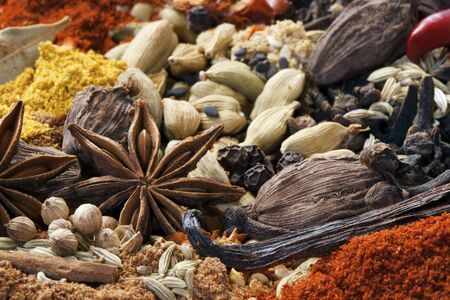 Various spices in full-frame.  Focus on star anise. photo