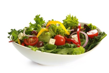 bowl: Greek salad in a stylish white bowl.  Isolated on white. Stock Photo