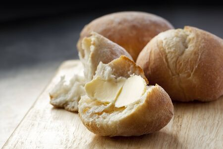 buttered: Buttered bread roll.  Lovely and crusty, ready to eat.