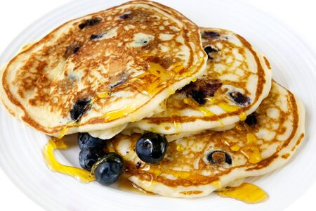 Buttermilk blueberry pancakes with maple syrup.  Delicious! photo