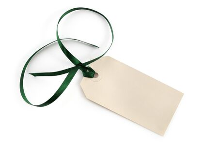 gift tag: Blank tag fastened with green satin ribbon, isolated on white with soft shadow. Stock Photo